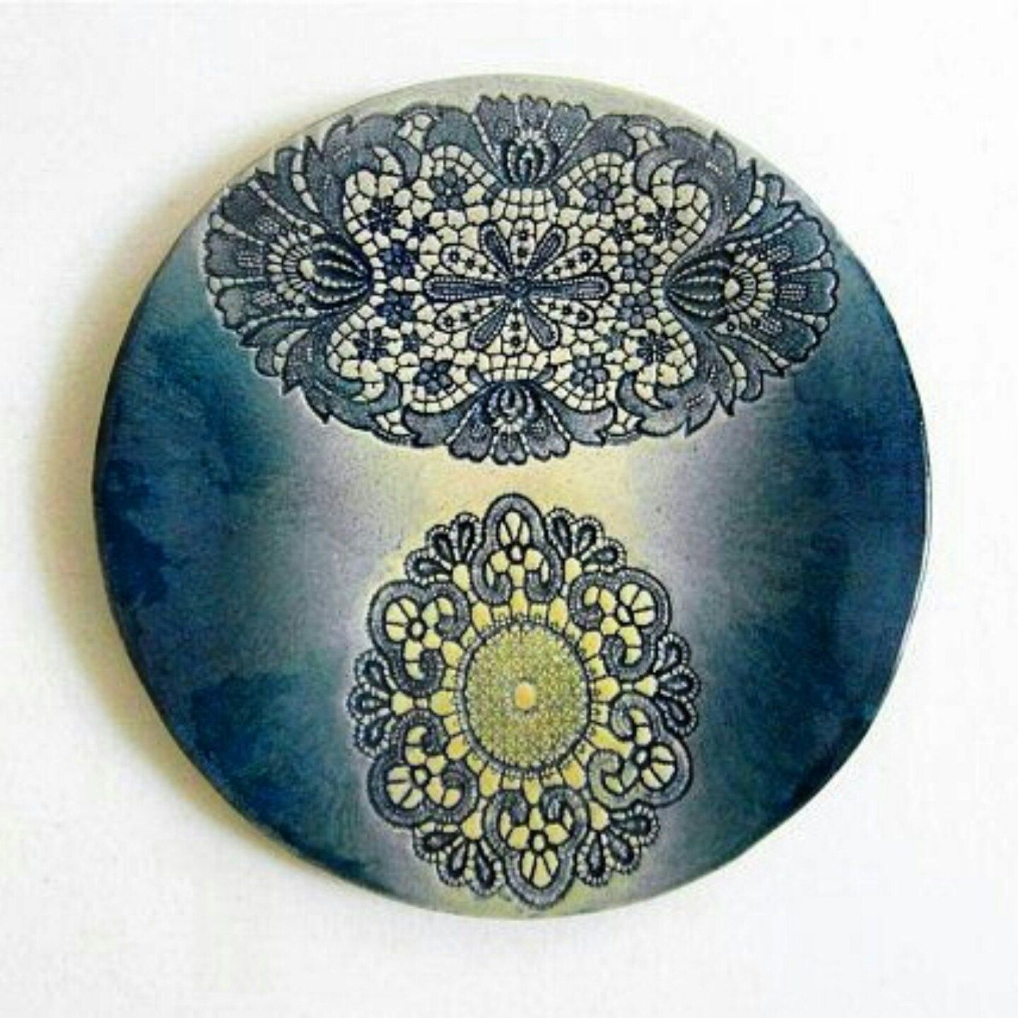 ceramic plague with lace ornament in ehtno style for interior decoration