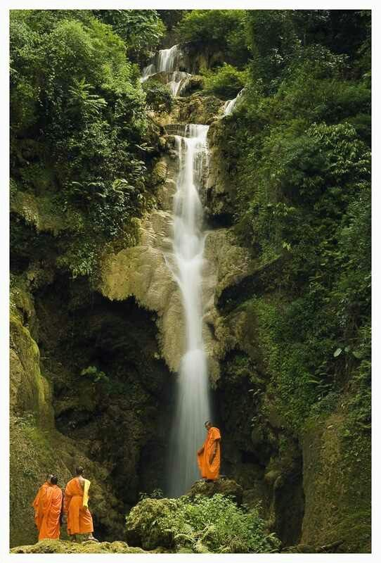Laos waterfall with monks
