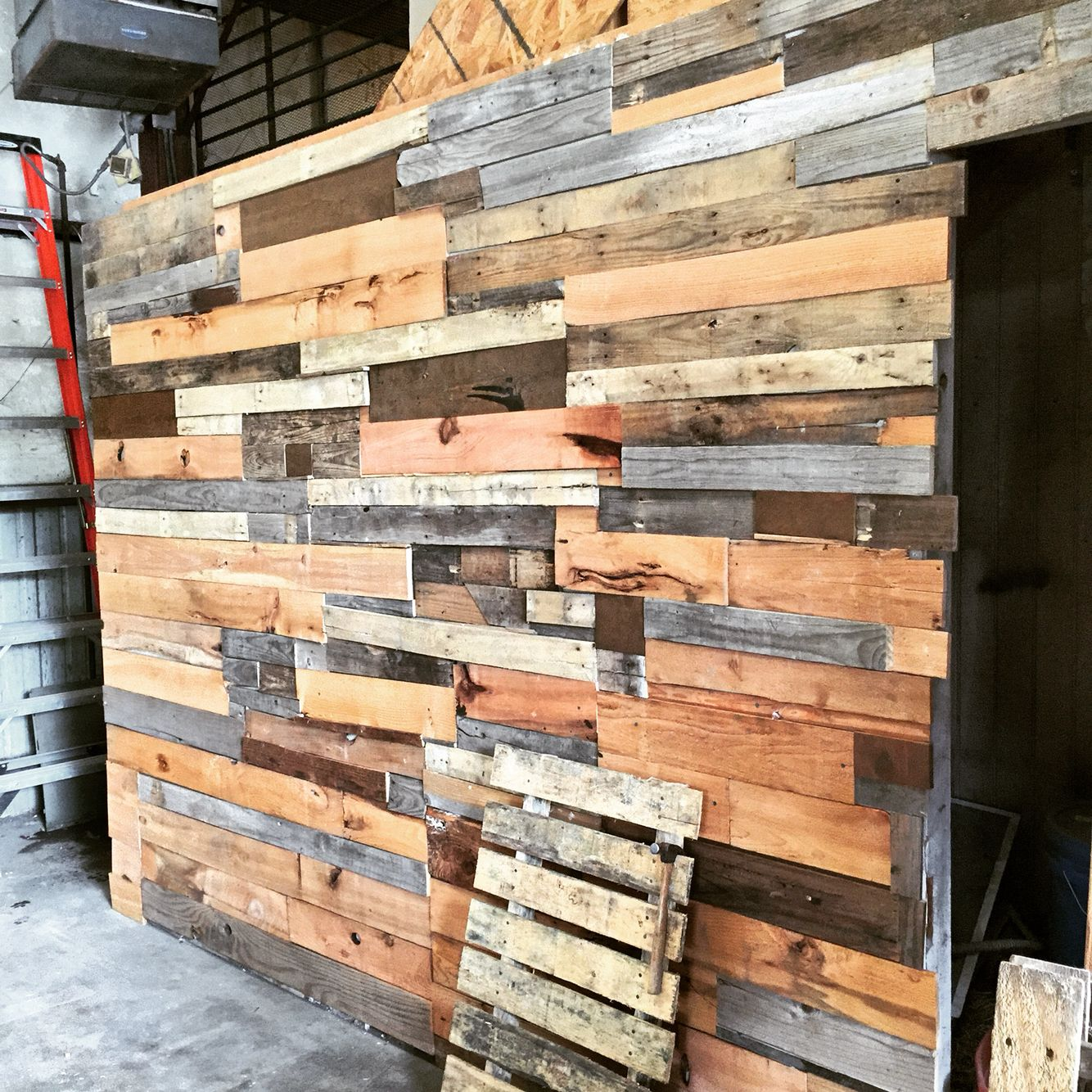 Wall panel inside industrial warehouse. Made from pallet ...