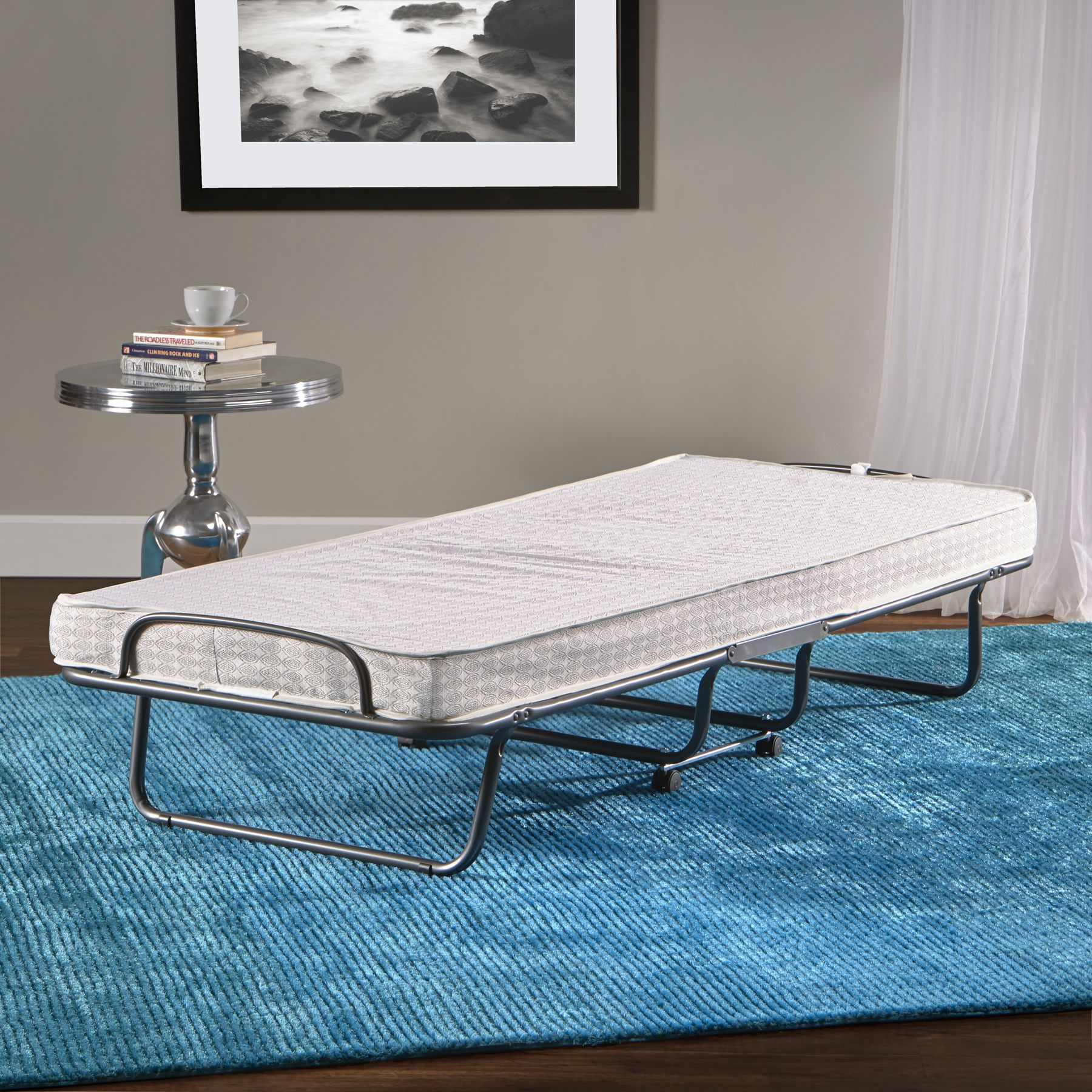 Adjustable rollaway guest bed by InnerSpace Luxury