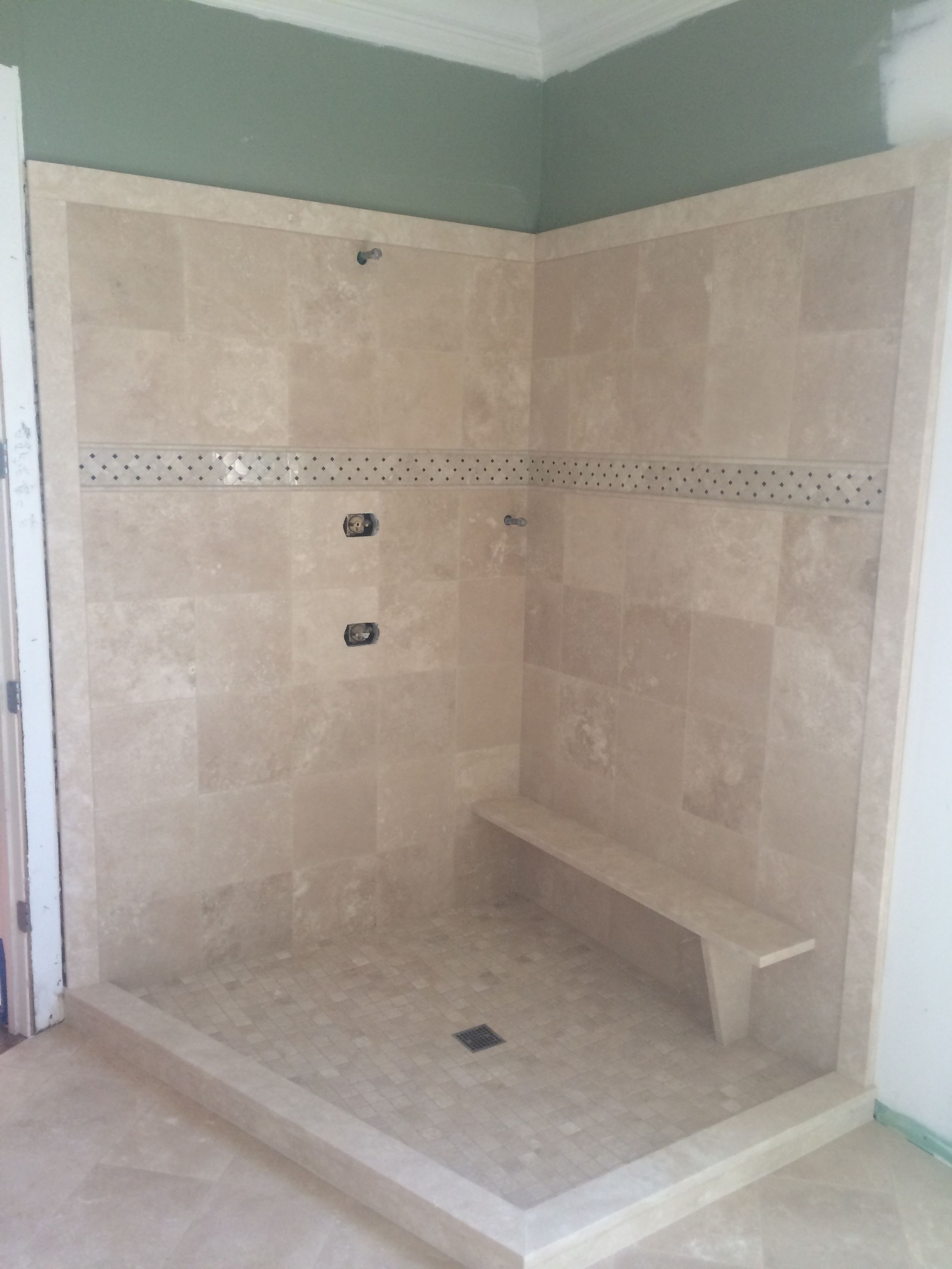 Travertine Shower Outlined With Natural Stone Travertine Slab Material And  A Floating Bench Seat For A