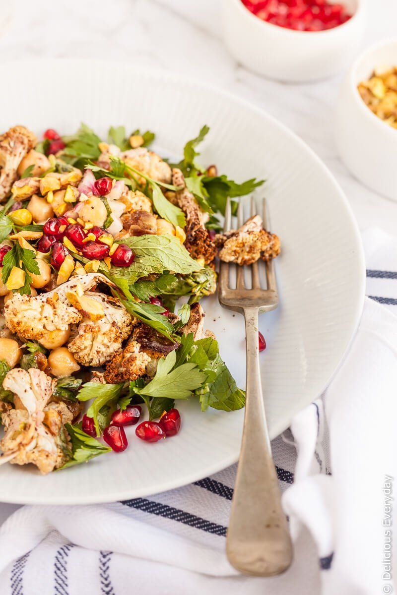 Think you don't like cauliflower? Think again! This Sumac Roasted Cauliflower Salad takes cauliflower to a whole new level. Paired with Medjool dates, pomegranate and mint and parsley this beautiful salad is an explosion of flavours and textures.