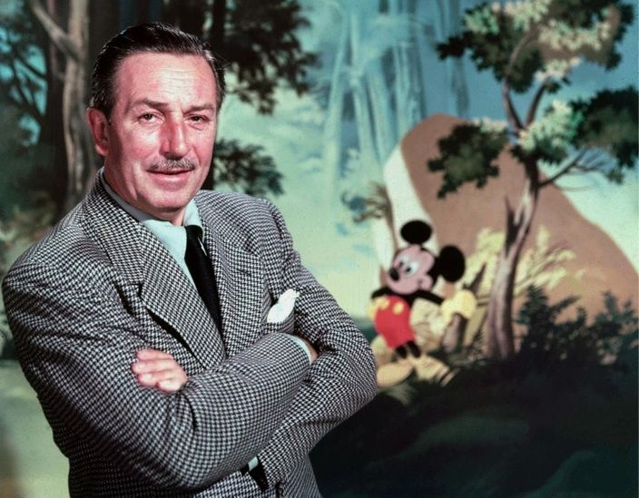 Walt Disney was the first UX professional (Portrait of Walt Disney with painting behind him with Mickey Mouse standing in a forrest).