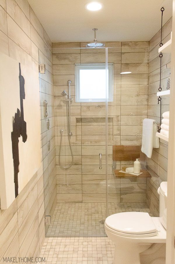 A Visit to the 2015 HGTV Smart Home in Austin, Texas - The look of wood and art in the bathroom and shower.