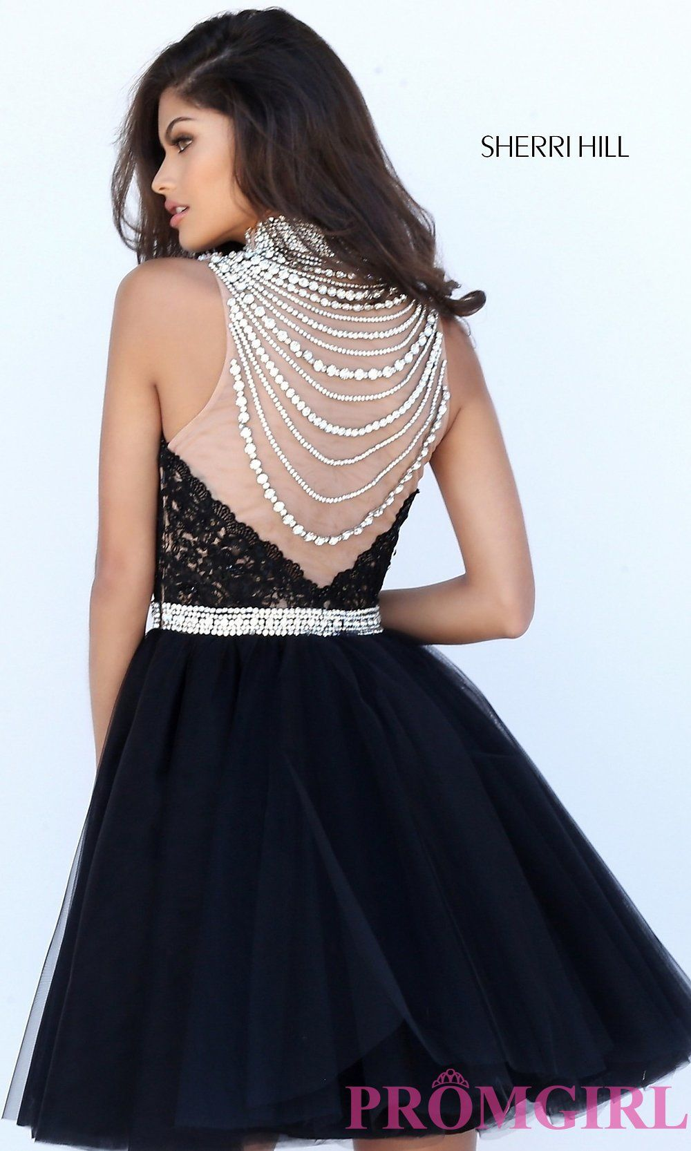 Sherri Hill 50538 is a sleeveless short party dress with a high, beaded  neckline, a sweetheart bodice, and a tulle skirt.