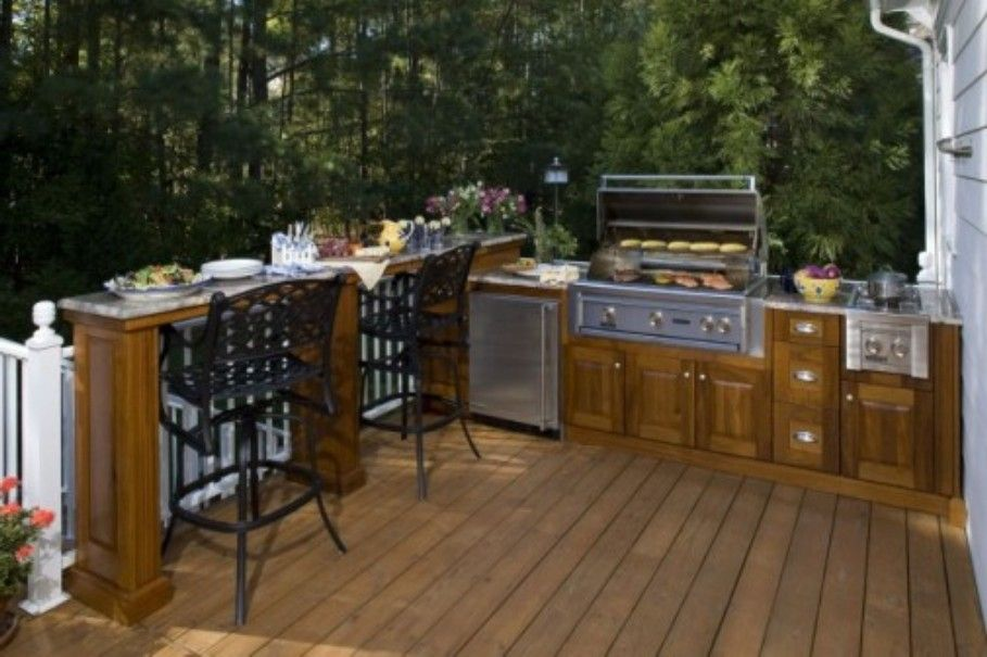Wooden Deck Outdoor Kitchen With Wood Kitchen Island Combined By Marble Connected With Chairs And L Outdoor Kitchen Outdoor Kitchen Plans Outdoor Kitchen Decor