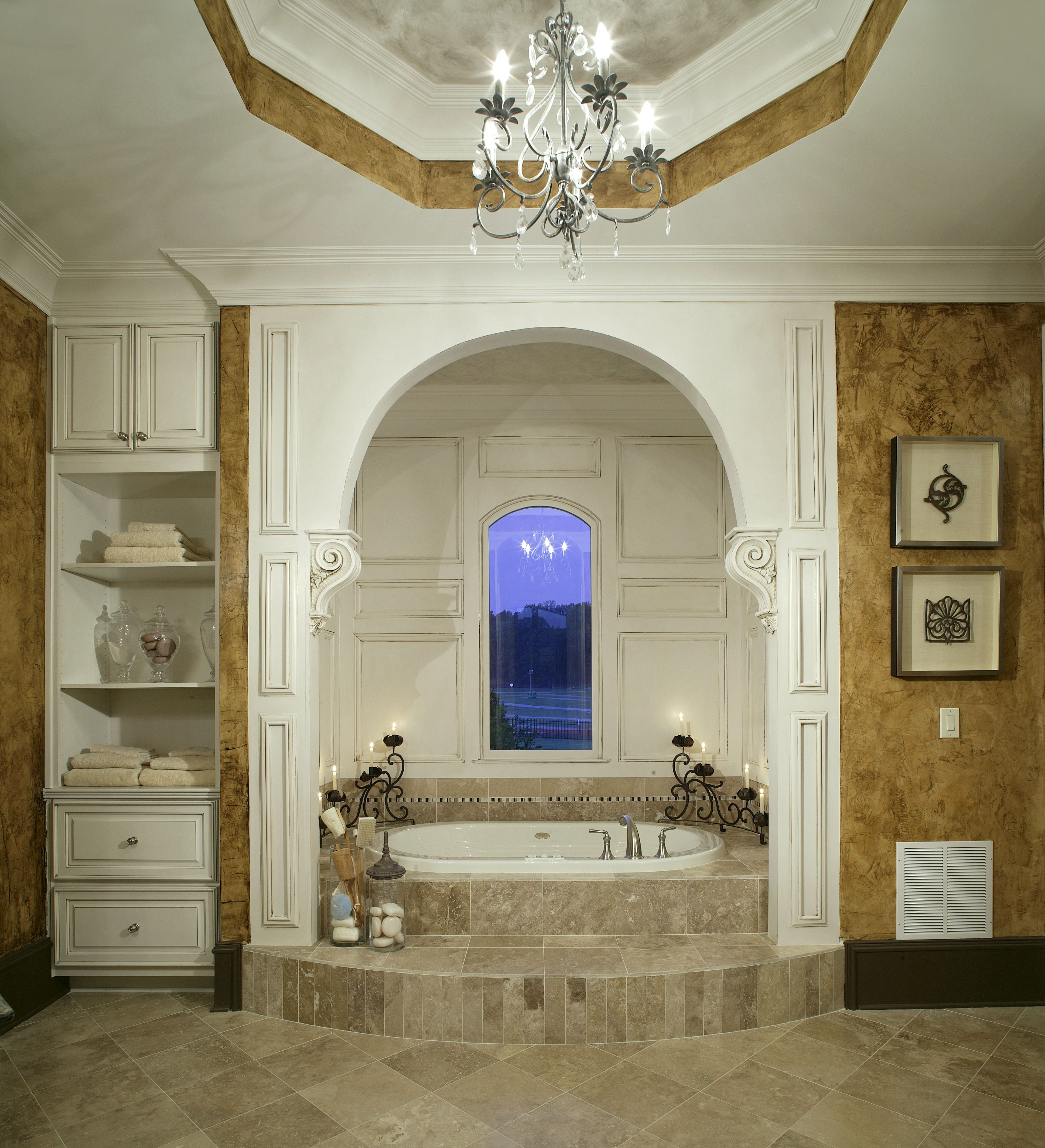 Renovated bathroom with antique white painted cabinets, a brown tile floor and of course, a large soaking tub.