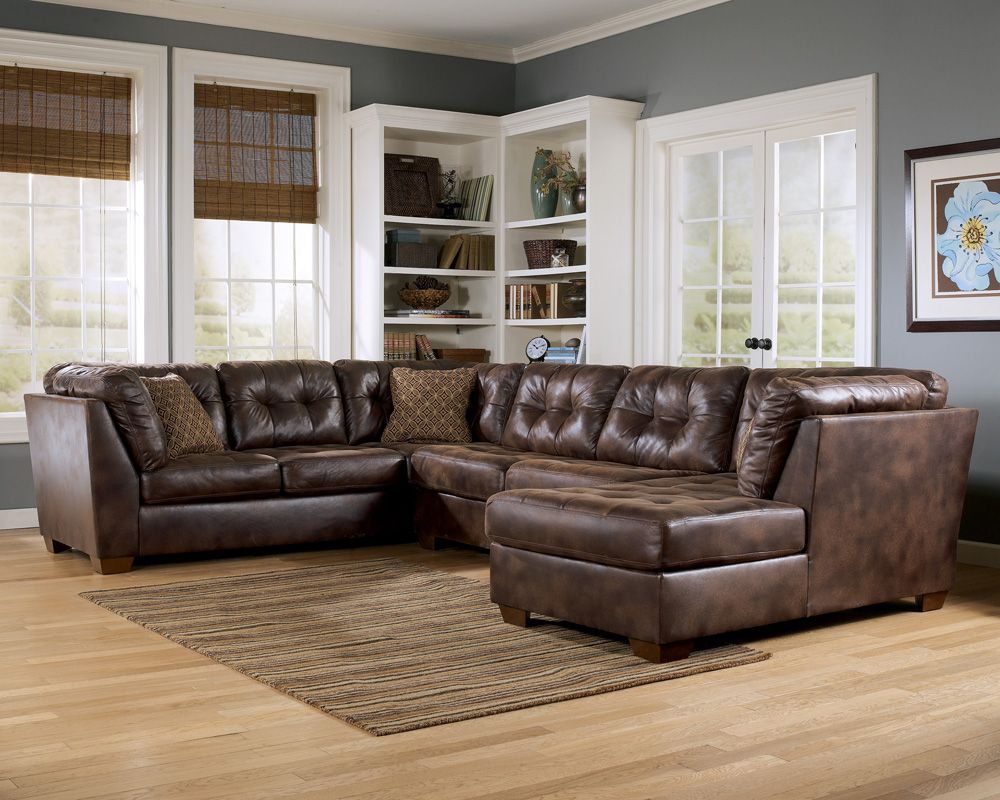 Appealing Living Room Furniture With Wooden Flooring And Grey Wall Paint  Color And U Shaped Brown Leather Sofa Set Feat Small Brown Fabric Pillows  And White ...
