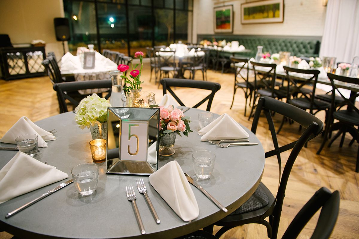 mirrored table numbers and simply elegant tables at the Oxford Exchange / photo: marissa-moss.com