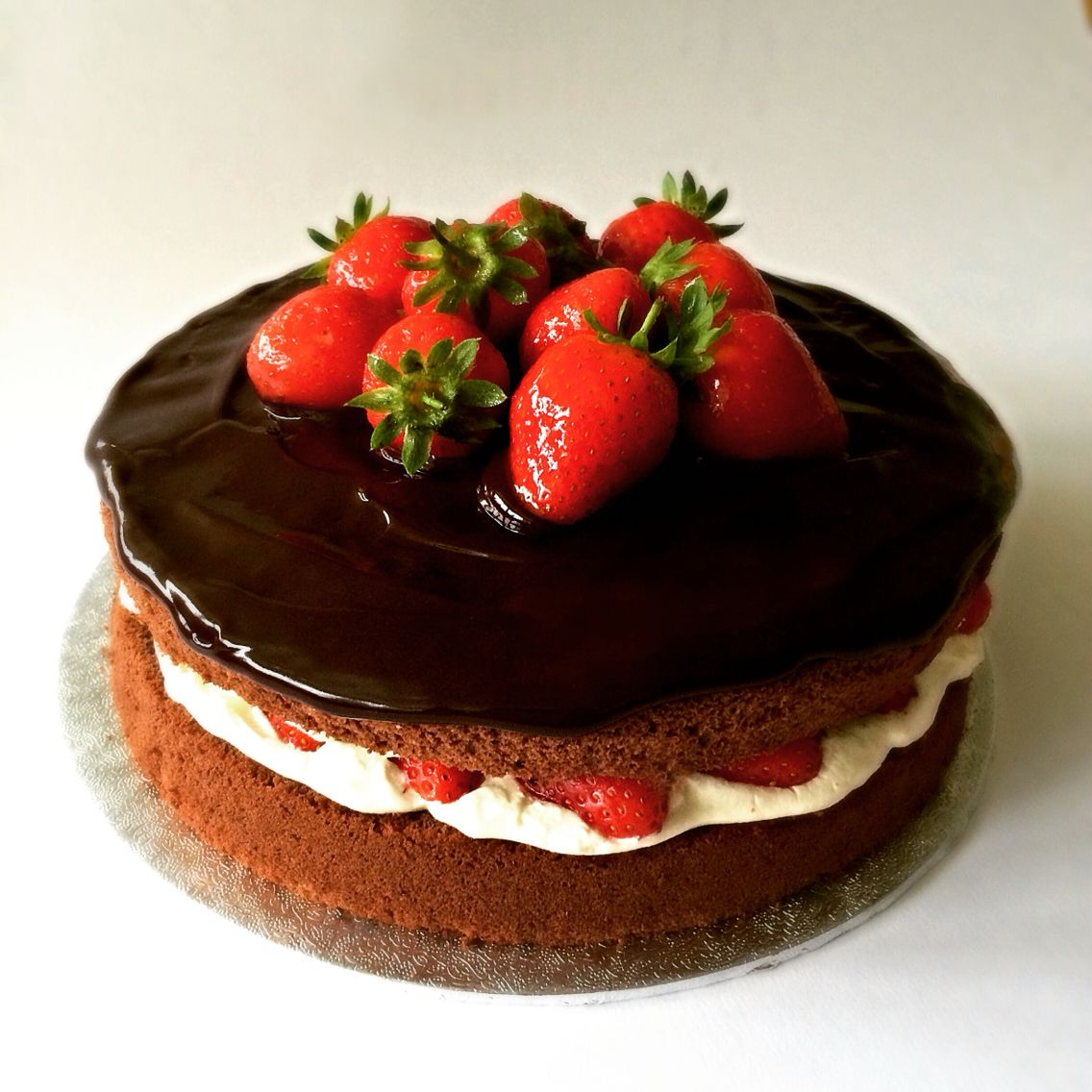 Chocolate sponge cake with strawberries, whipped cream and ...