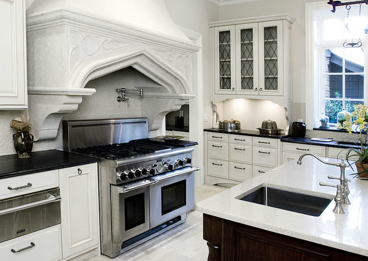 Suzie Ecomanor Gorgeous Two Tone Kitchen Design With Soft Gray Walls Paint Color White Glass Fronted Kitchen Cabinets