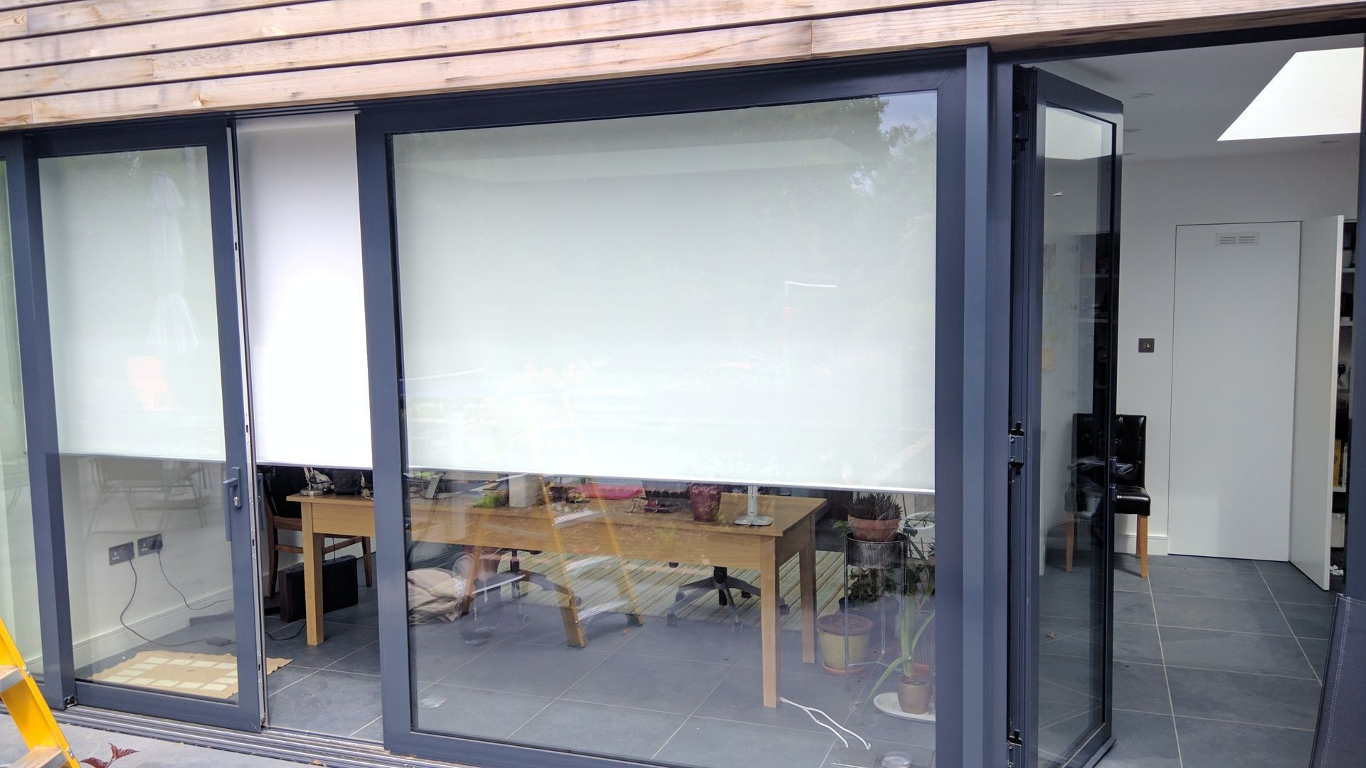 Roller blinds from our basics range fitted to sliding doors in west