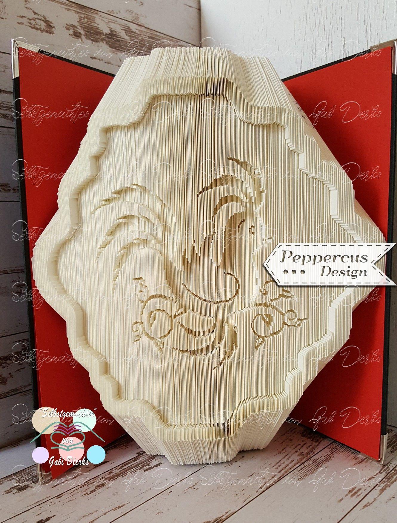 Buchfaltkunst mit einer Grafik von Peppercus Design und einem Rahmen ...