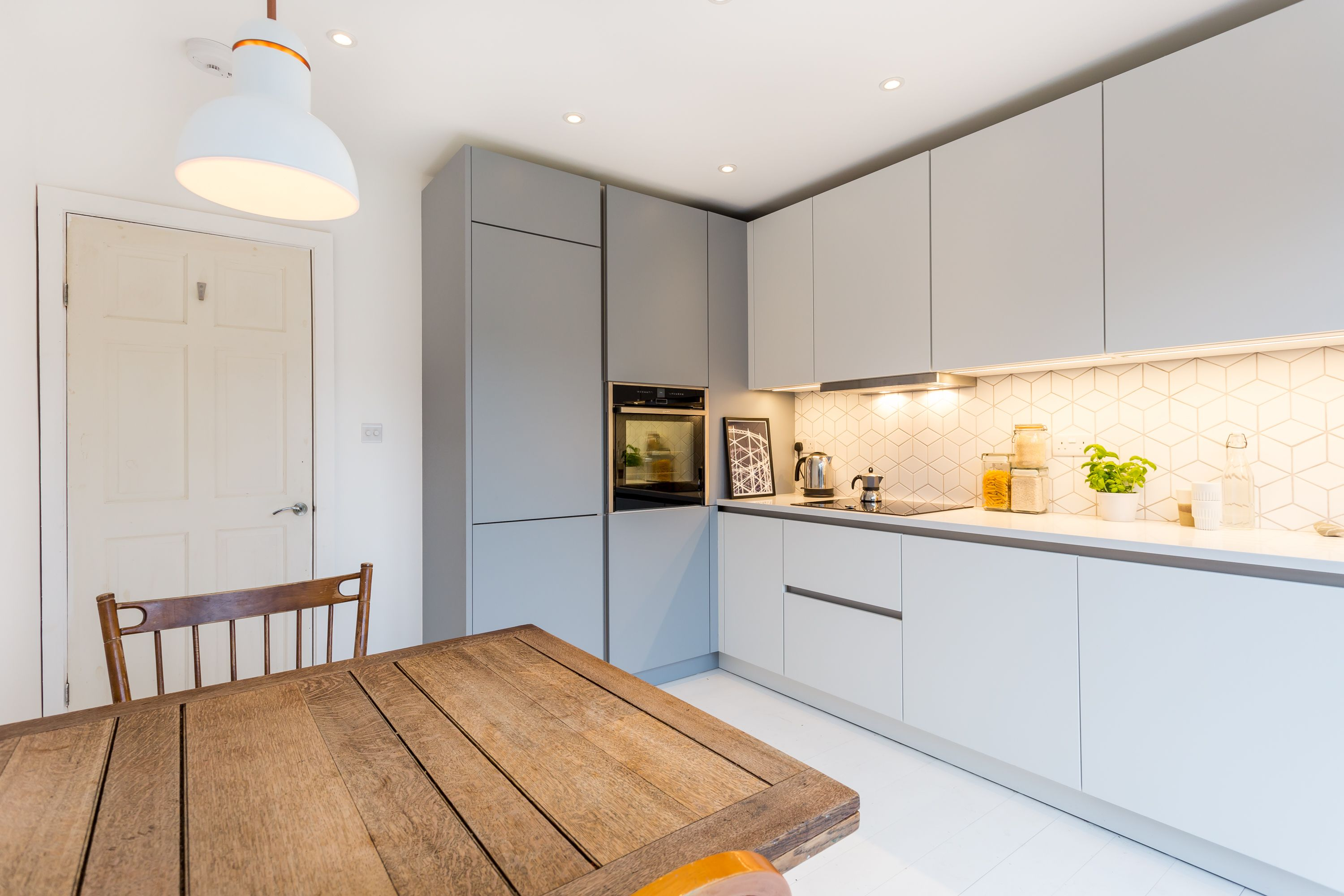 A Beautiful Nolte Soft Lac Handleless Kitchen In Papyrus Grey And White.  With Bi