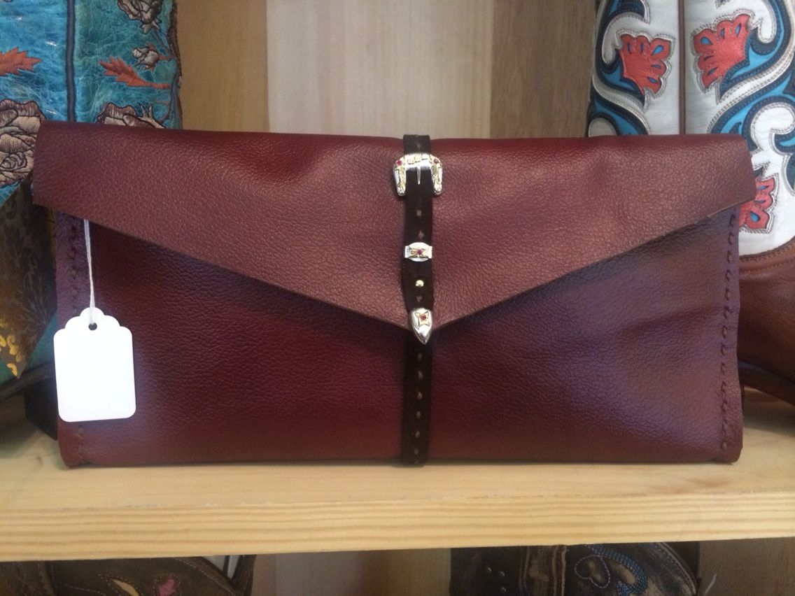 Wine leather clutch with buckle closure and hand stitched detail - SOLD.