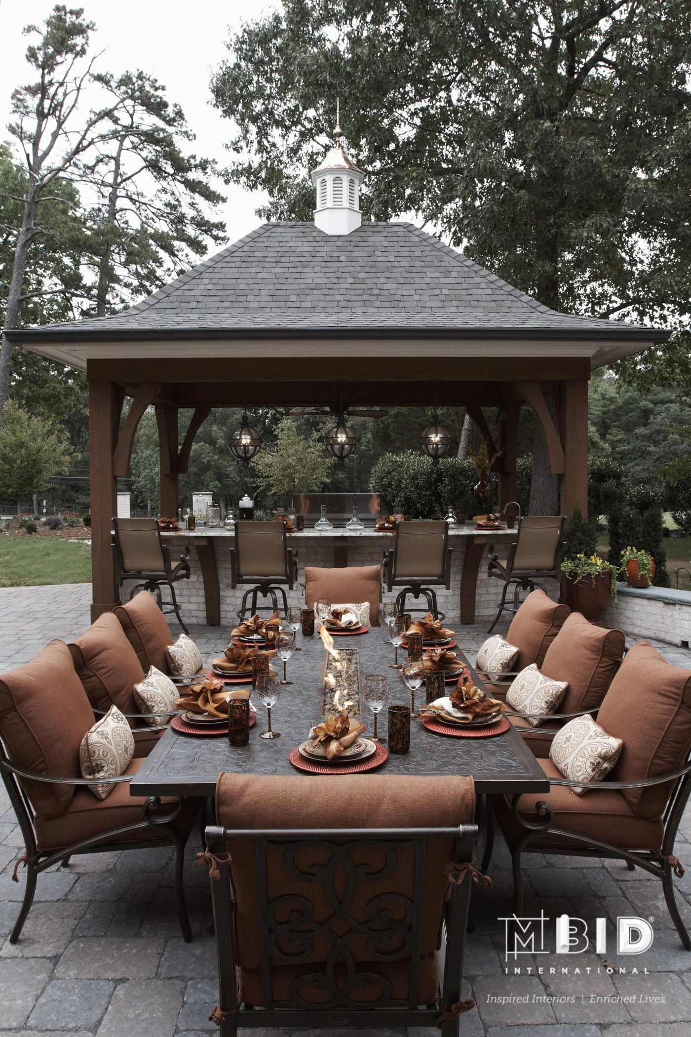 Garden fire features  Greensboro NC Outdoor Kitchen Design The large dining table has a