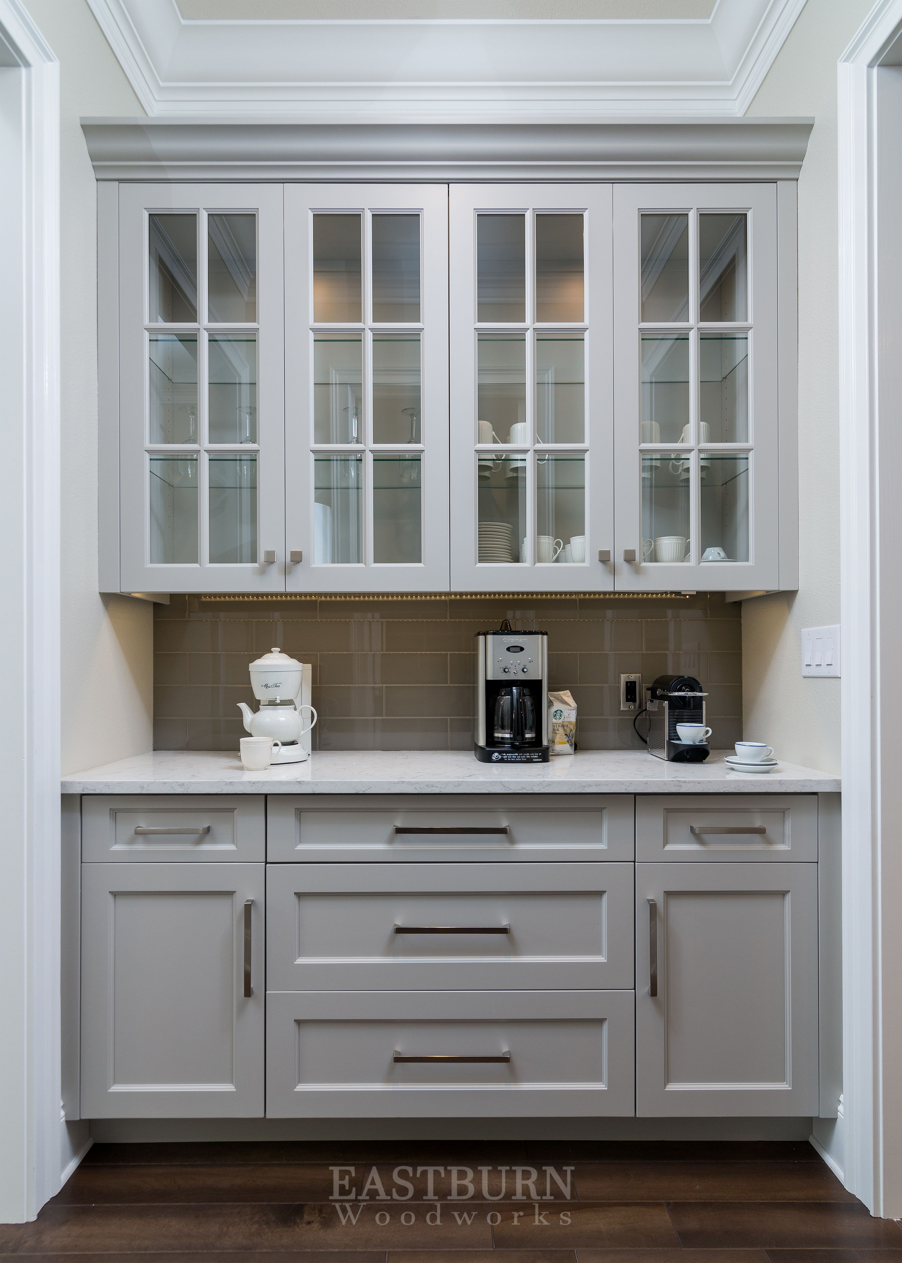 Butlerus pantry with gray painted cabinets and topknobs bar pulls