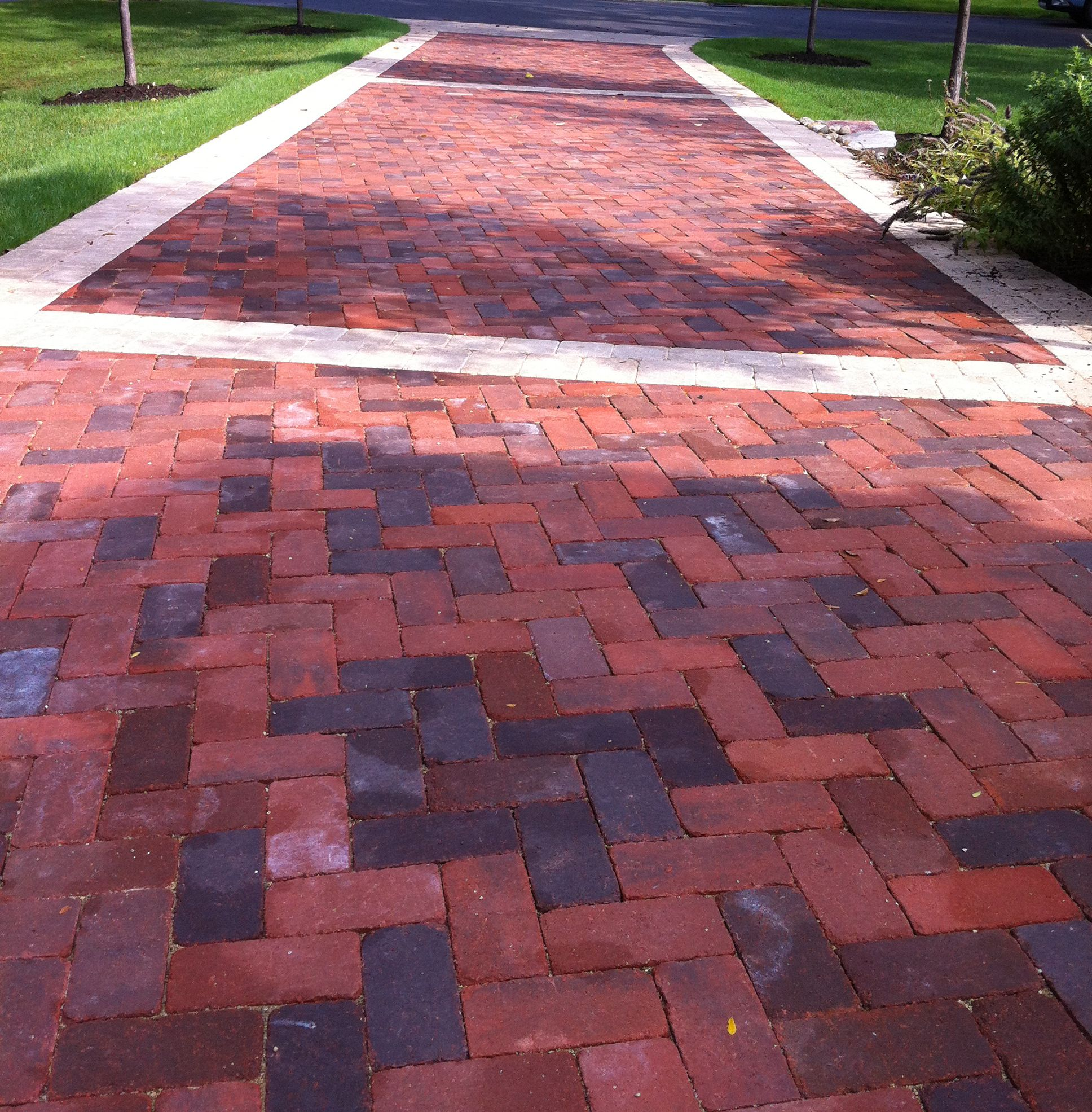 large driveways are beautiful with brick or stone