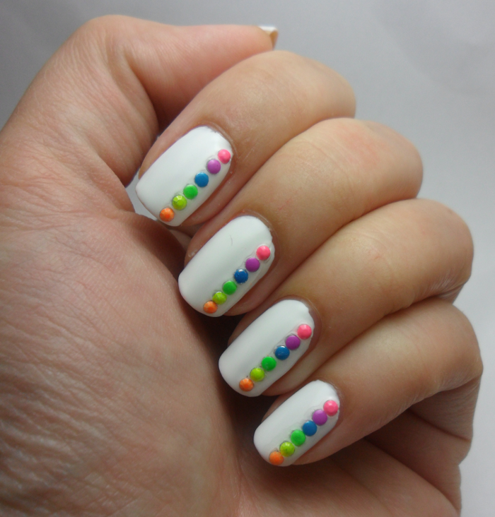 White nails with neon studs