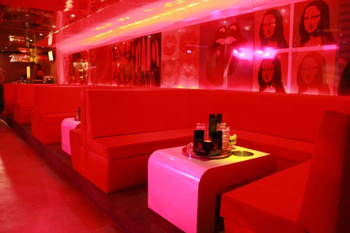 Red Leather Booths And Prints Of Andy Warhol S Famous Art Works Line The Wall Inside Dance Club