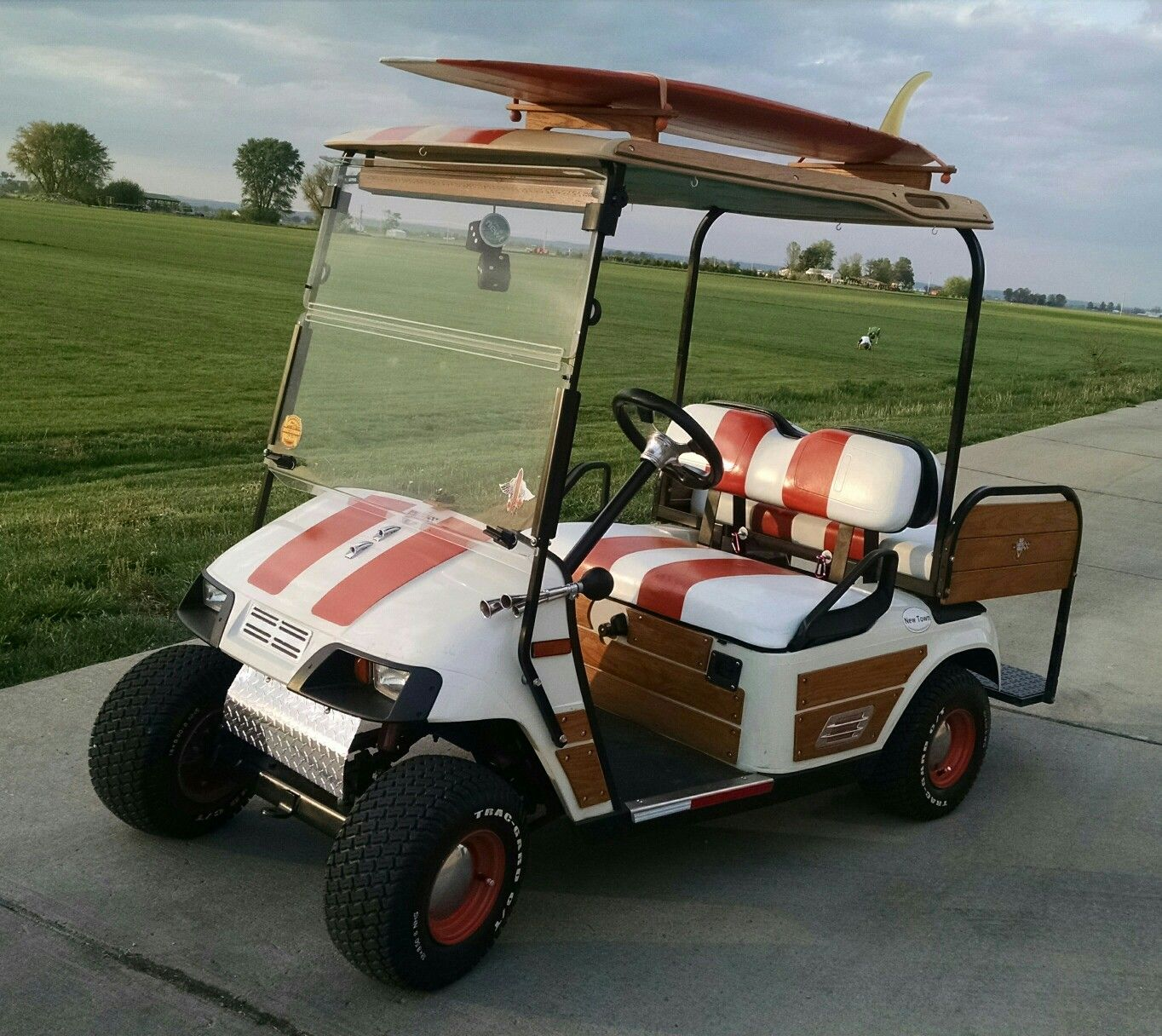 Modified EZGO Woody. Natural Wood panels and trim.crafted by owner on garage wood, tools wood, boat wood, golf rack wood, truck bed wood, construction wood, trailer wood, umbrella wood, wagon wood, rolls royce wood, landscape wood, hot tub wood, car wood, eagle wood, kayak wood,
