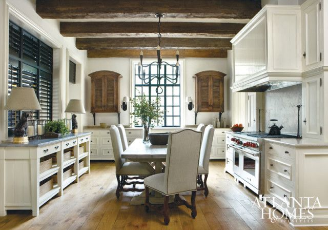 Beamed ceilings, wide-plank oak floors and iron windows pour on the charm.