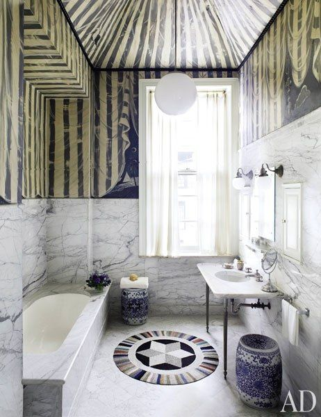 Lined with marble and accented with a pair of antique Chinese garden stools, the space adds whimsical flair to the historic house.