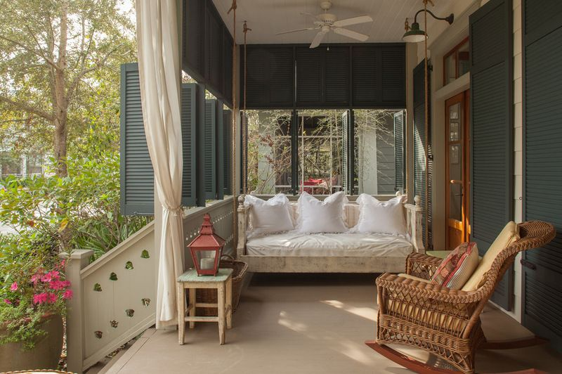 In this Florida cottage, the old-style shutters can be opened and closed for privacy and shelter from the weather. Imagine settling down on the cushy porch swing for an afternoon nap with the ceiling fan to keep you cool. Heaven!