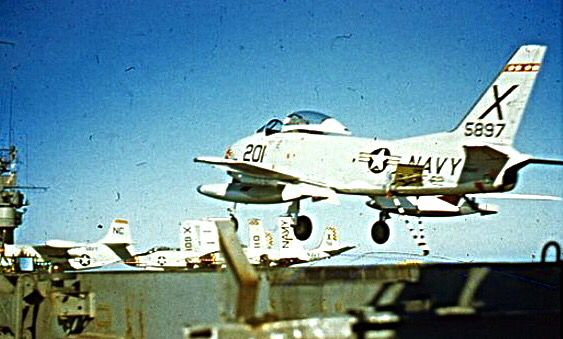 """An FJ-3 Fury from VF-62 """"Boomerangs"""" Fighter Squadron makes a landing on the carrier,"""