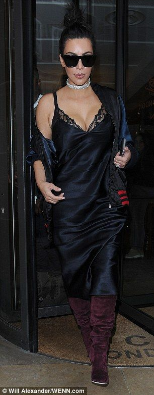 Work it: Kim looked sensational in her lingerie-inspired dress and suede boots as she left the eatery