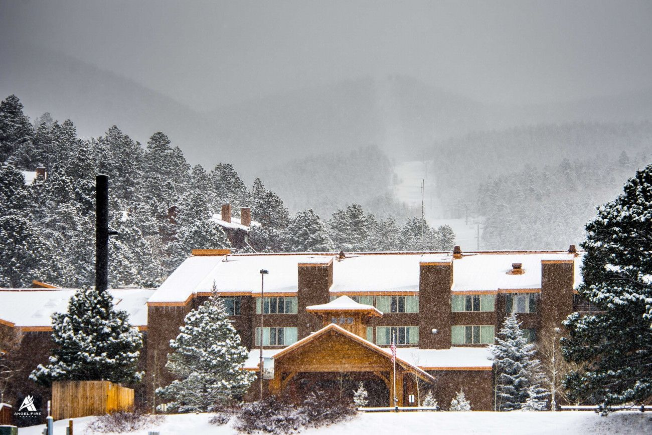 snow falling at the angel fire resort lodge. | angel fire scenery