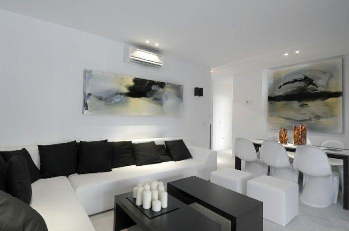 wanddesign wohnzimmer wandgestaltung weiße möbel schwarze dekokissen ...