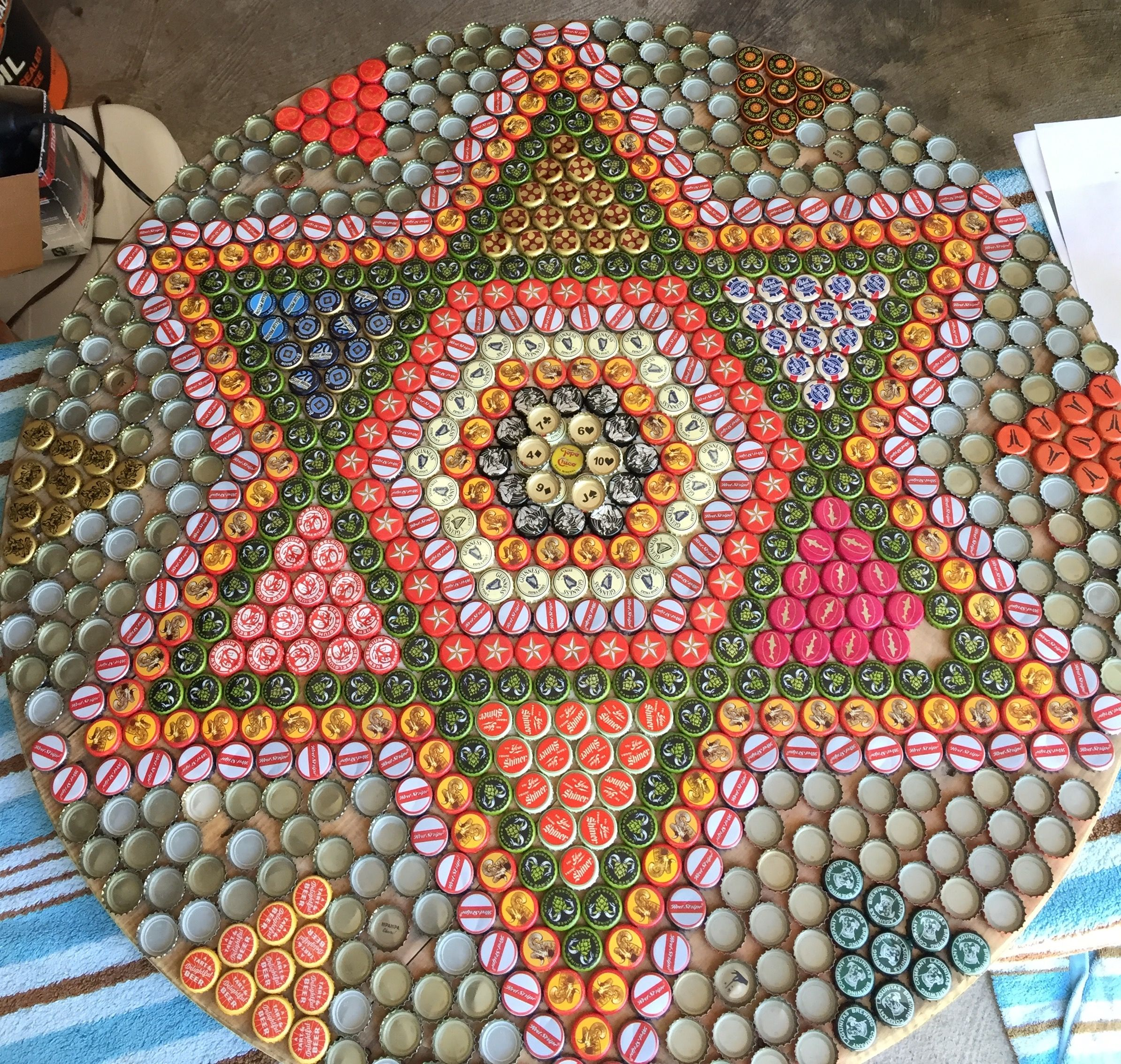 Bottle cap outdoor table made out of wooden spool end