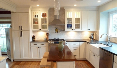 Kitchen With Mullion Glass Door Cabinets On Either Side Of