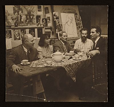Citation: Carl Holty, Joan Miró and others having tea in a studio, 1947 / unidentified photographer. Carl Holty papers, Archives of American Art, Smithsonian Institution.