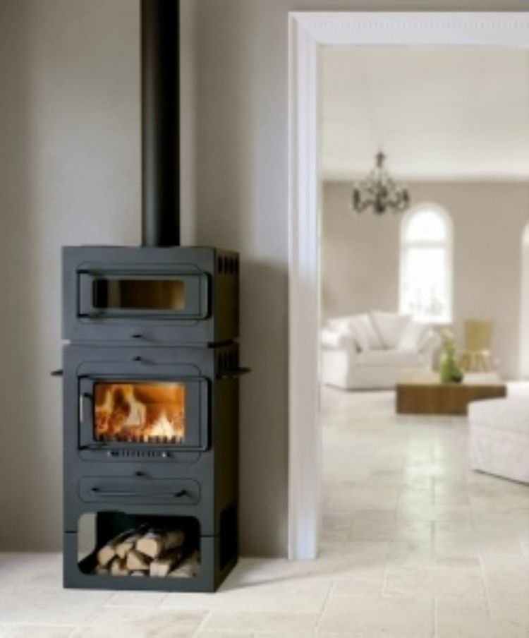 An interesting little stove with a smiley face and wide glass for ...