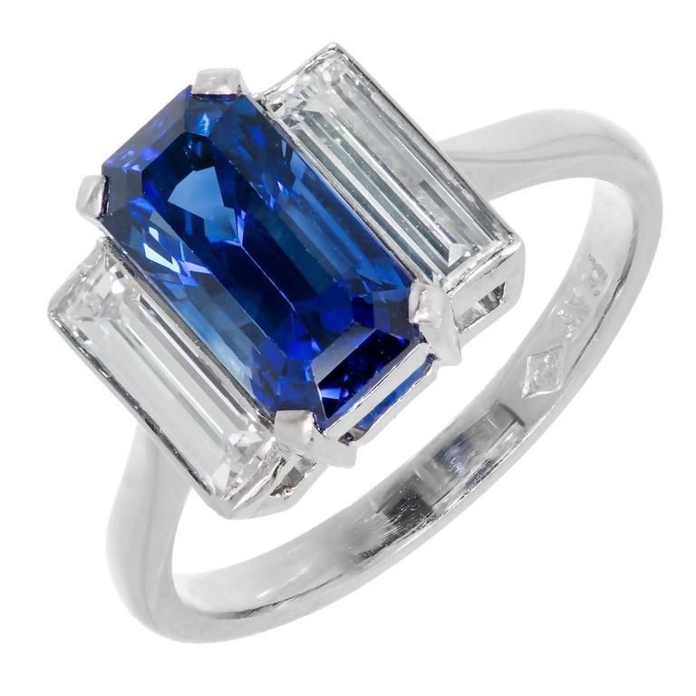 Emerald Cut Sapphire Diamond Platinum Three-Stone Engagement Ring | From a unique collection of vintage engagement rings at https://www.1stdibs.com/jewelry/rings/engagement-rings/