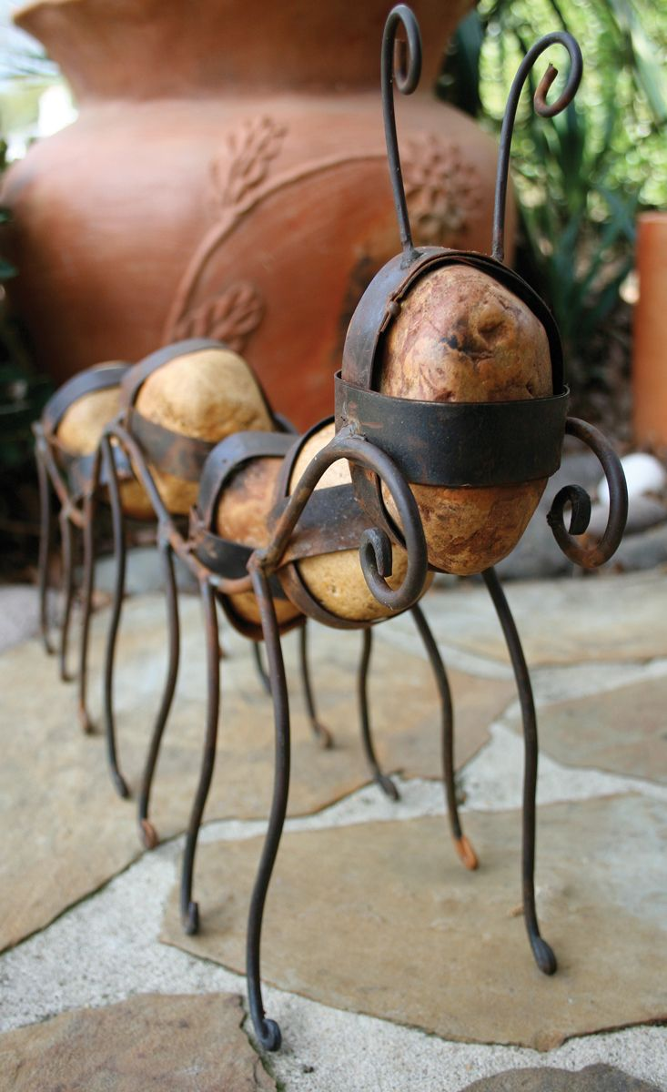 caged rock caterpillar sculpture