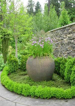 Rustic urn with chives, fennel and herbs