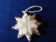 These are plastic canvas snowflakes - 3 layers put together into one with coloured beads on each point. These will make a lovely addition to your tree.    This listing is for 1 snowflake. There are currently 6 available.