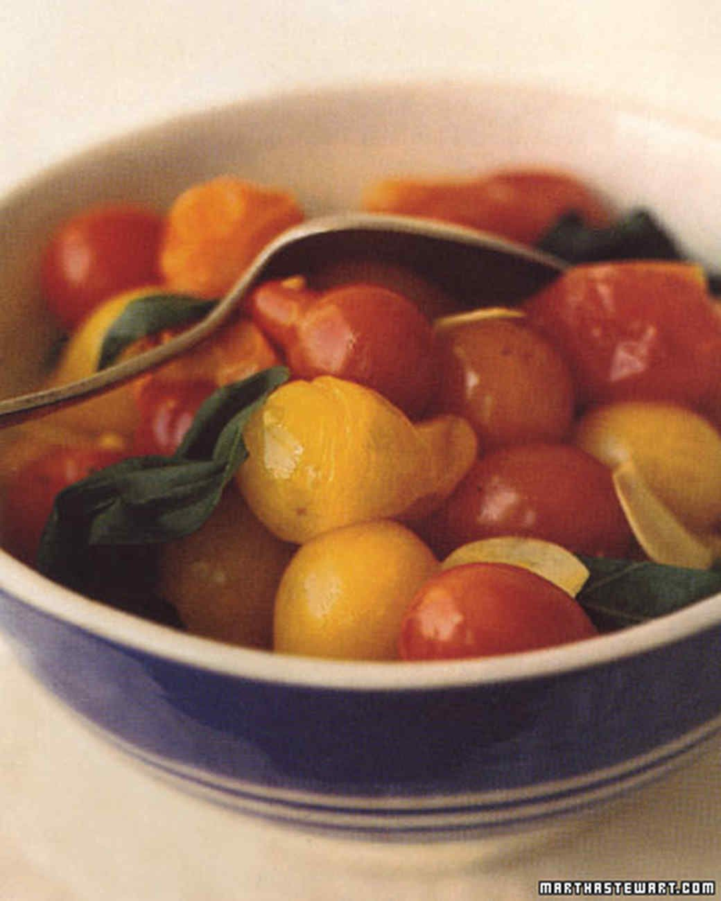 Heat plumps the tiny tomatoes, creating a luscious compote to top grilled foods or serve as a side dish.