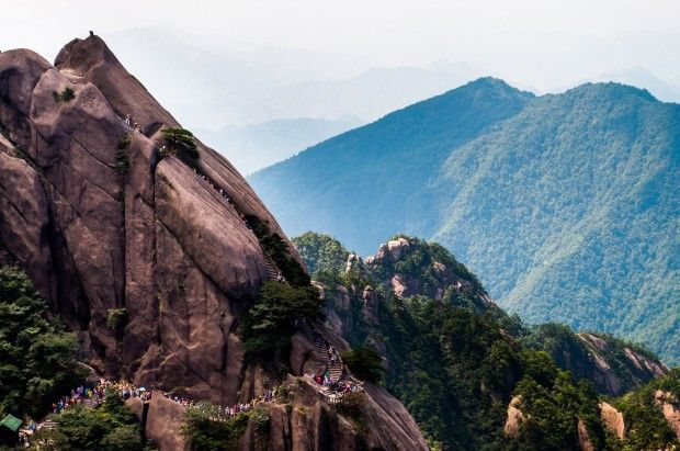 Rocky Peaks of Mountain Huangshan Floating Among the Clouds