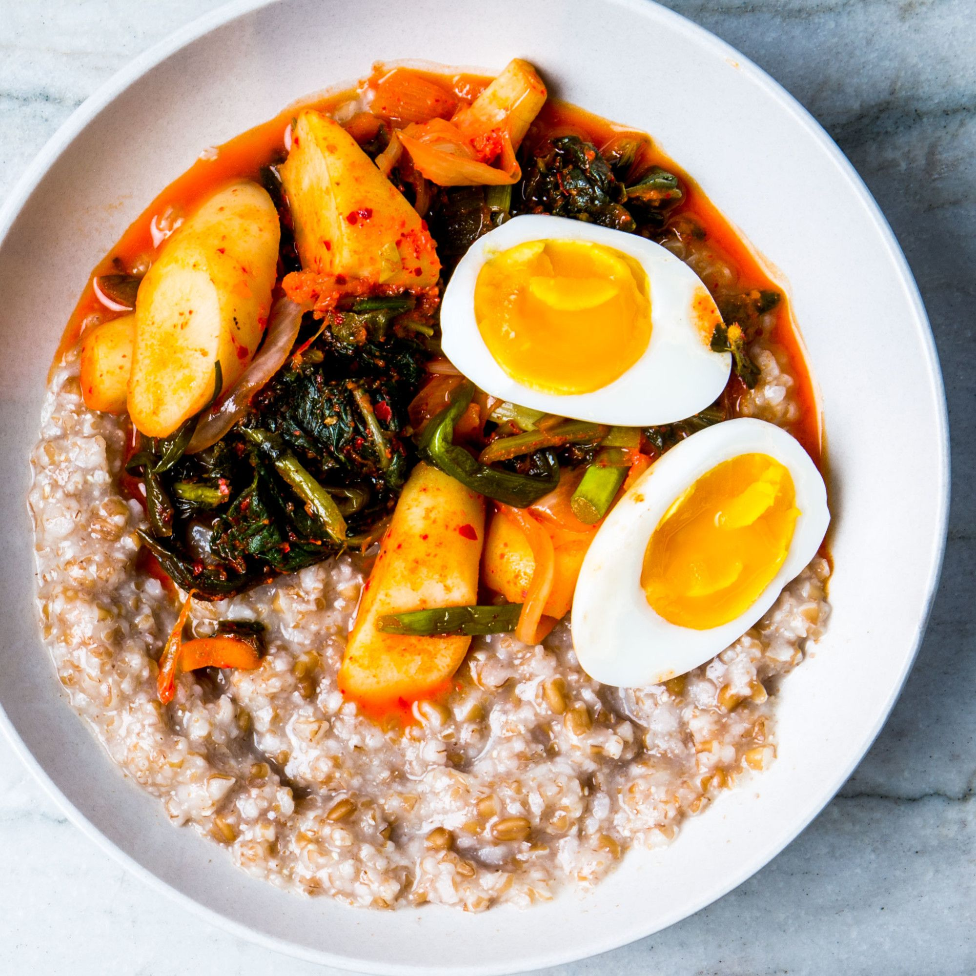 Kimchi gives this porridge recipe a spicy twist, while the 6-minute egg keeps it hearty and perfect for breakfast.