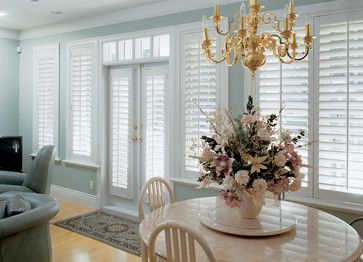 if we find the need for WT at back of living room this could work Door Applications - traditional - living room - boston - Sunburst Shutters & Window Fashions - New England