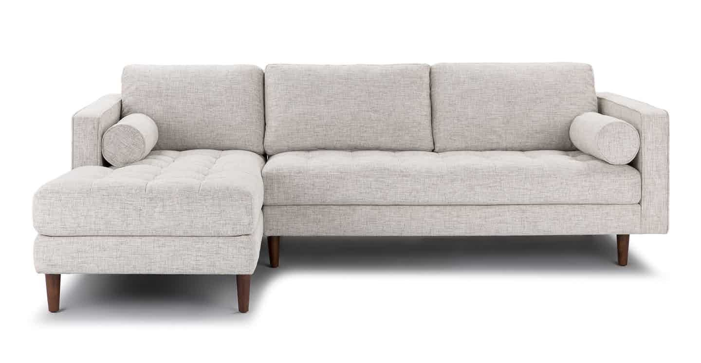 Theres a reason this is our most popular sofa this modern take on a mid century classic features crisp lines a tufted benchseat and three luxuriously