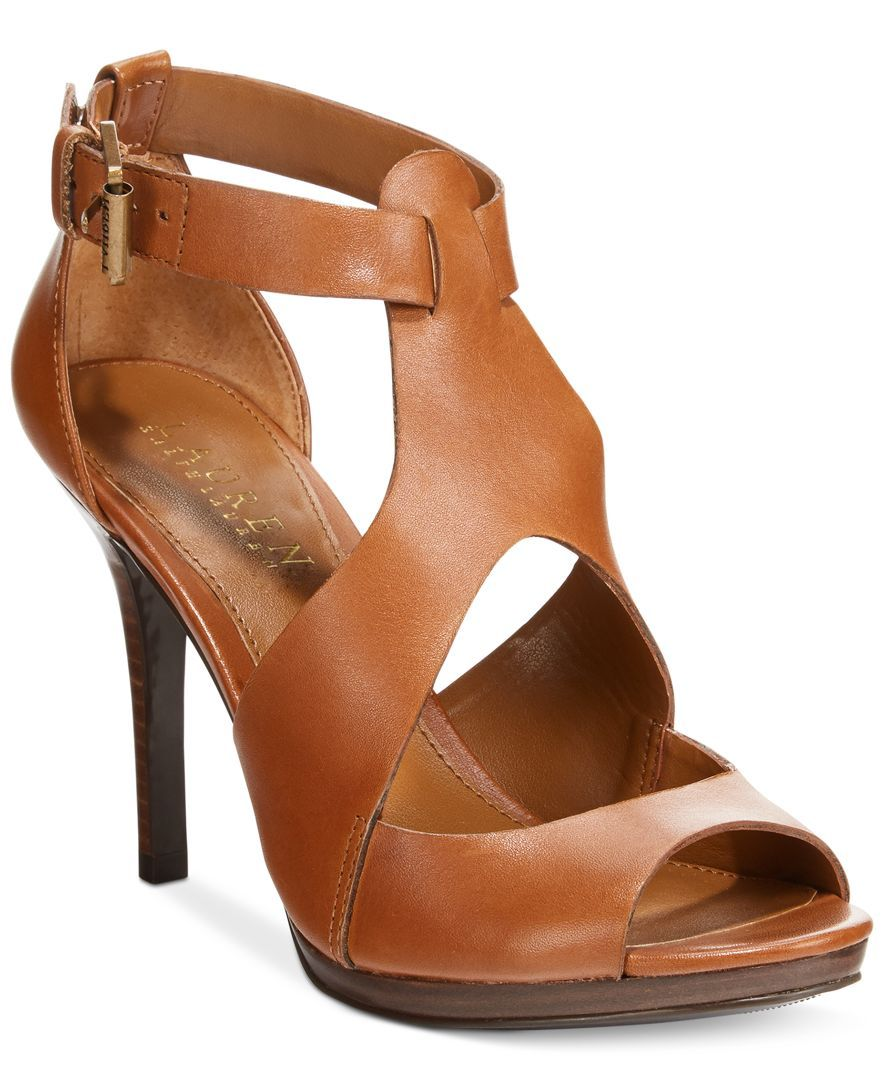 659448644ad529 Sexy leather with peep-toe and cutout details make the Beth sandals from Ralph  Lauren an easy choice for both day and night looks.
