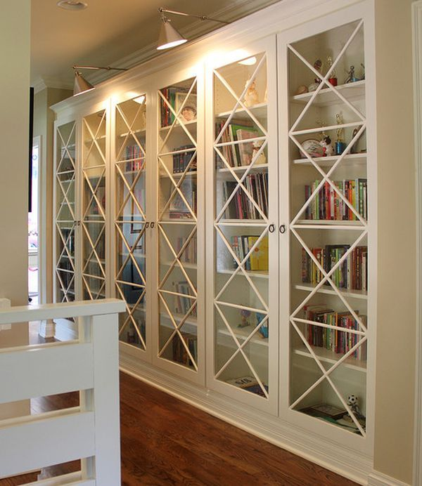 Room These X Motif Custom Designed Gl Doors Along With Library Lighting Give Bookcases