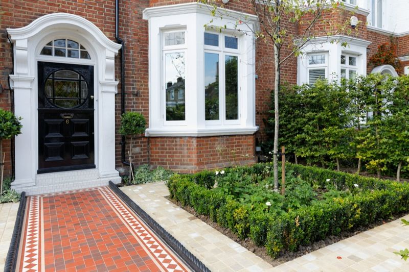 Box hedging and box balls are used to create an air of ...