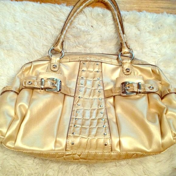 Never used gold purse Still has tag inside! Never used. Perfect condition Kathy van zeeland Bags