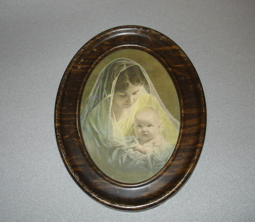 Wonderful Color Print Of A Mother Holding Her Infant In An Oval Metal Frame All